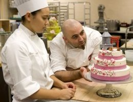 Duff Goldman '98 works with CIA Baking and Pastry Student