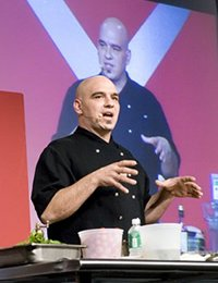 Michael Symon 90 gives a cooking demonstration for CIA students