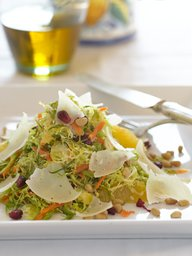 Cavoletti alla Crudaiola con Mandarino, Melograno e Pignoli- Shaved Brussels Sprouts Salad with Clementines, omegranate, Pine Nuts, and Cheese.