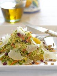 Cavoletti alla Crudaiola con Mandarino, Melograno e Pignoli- Shaved Brussels Sprouts Salad with Clementines, omegranate, Pine Nuts, and Cheese.