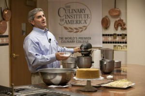 George Chookazian '93 talks to conference attendees in Danny Kaye Theatre during the Gluten-Free Culinary Summit hosted by The Culinary Institute of America.