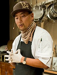 Roy Choi '98, gives a demonstration at the CIA's Worlds of Flavor Street Food conference