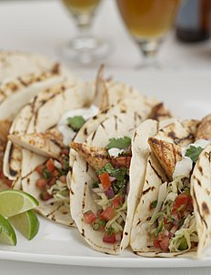Baja-Style Fish Tacos with Southwestern Slaw, Chipotle Pico de Gallo, and Mexican Crema - recipe by The Culinary Institute of America.