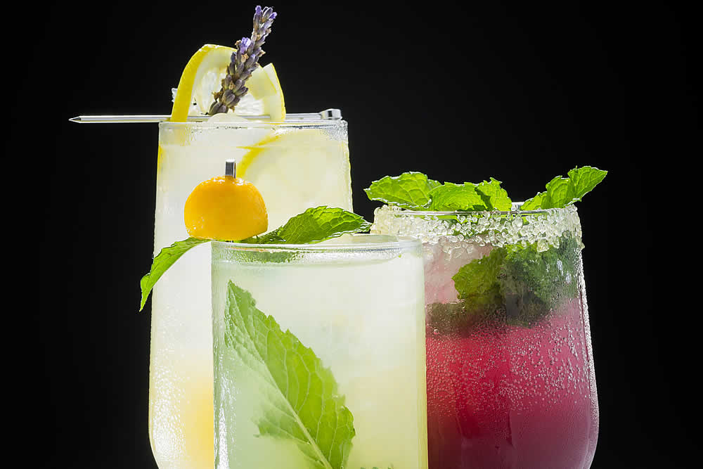 Try these Labor Day end of summer cocktail drink recipes by the CIA: Minted Mango Spritz, Lavender Lemonade, and Pomegranate Ginger Fizz.