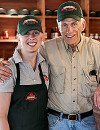 CIA alumna, Katie Ferris poses with her dad at Zoe's Ice Cream Barn