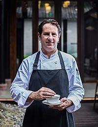 Headshot photo of CIA culinary arts alumnus, Joshua Nudd