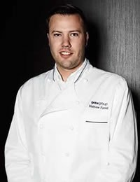 Photo of Matthew Farrell, Customer Dedicated Executive Chef for American Airlines and CIA culinary arts graduate