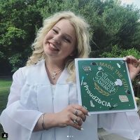 Photo image of Aurora's high school graduation cap topper