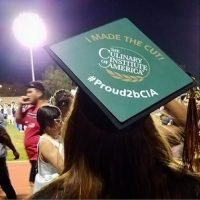 Photo image of Caitlin's high school graduation cap topper