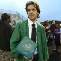 Photo image of Ethan's high school graduation cap topper
