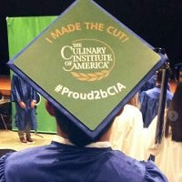Photo image of Francisco's high school graduation cap topper