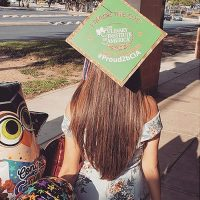 Photo image of Izzy's high school graduation cap topper