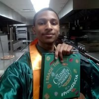 Photo image of Jahqyad's high school graduation cap topper
