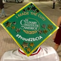 Photo image of Marco's high school graduation cap topper