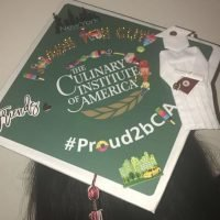 Photo image of Naya's high school graduation cap topper
