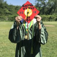 Photo image of Perry's high school graduation cap topper