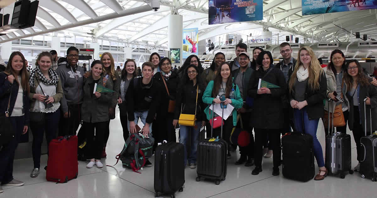 Photo image of CIA students at the airport on an instructional trip to France