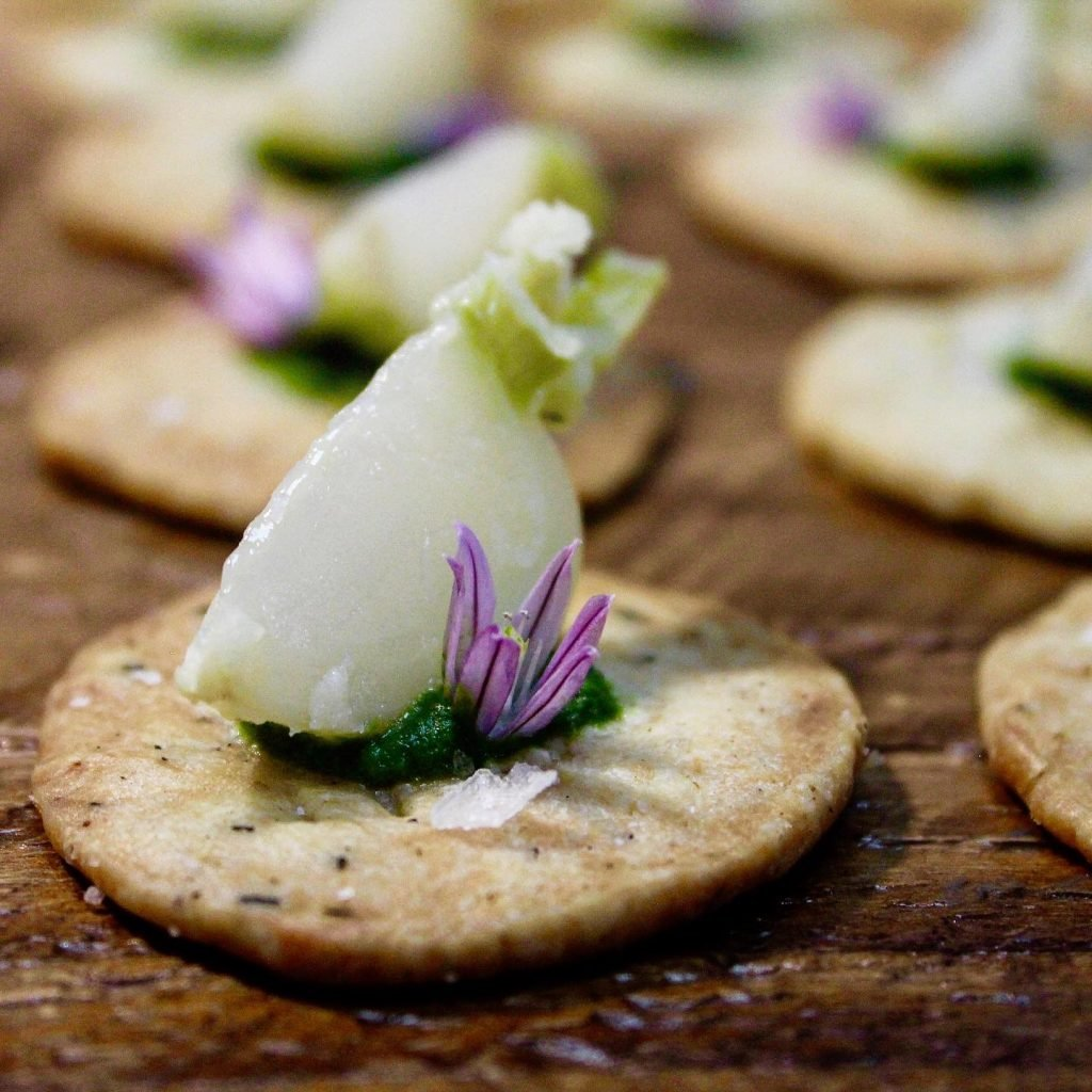 Butter-poached turnip on a crispy thyme cracker